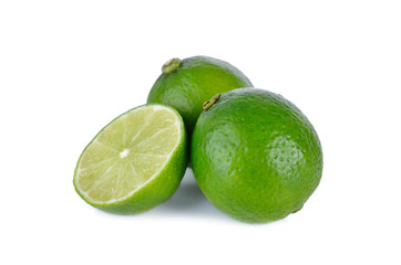whole and half cut fresh lime on white background