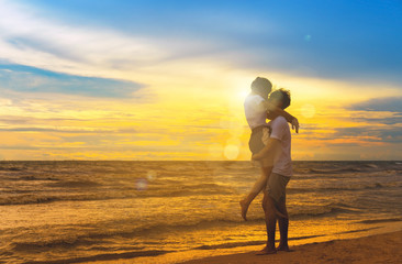 Young man and girl couple romantic leisure in celebration before married happy and fun at beach sunset vacation holidays, valentine day concept silhouette.