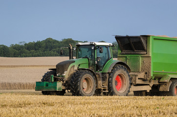 TRACTOR- Transport of mown grain from the field
