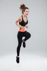 Full length picture of screaming fitness woman