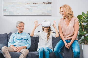 granddaughter using virtual reality headset