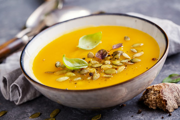 Pumpkin soup with basil leaf