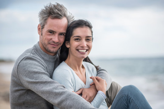 Portrait of a middle-aged couple sitting on the beach