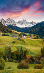 Magnificent view of Santa Maddalena village in front of the Geisler or Odle Dolomites Group. Colorful autumn sunset in Dolomite Alps, Italy, Europe. Artistic style post processed photo.