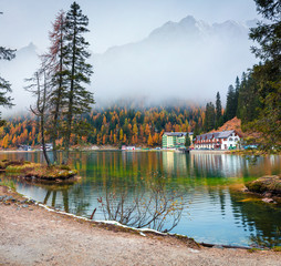 Foggy morning scene on Misurina lake in National Park Tre Cime di Lavaredo. Colorful autumn landscape in Dolomite Alps, South Tyrol, Location Auronzo, Italy, Europe.