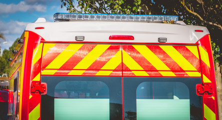 flashing light on a red ambulance firefighters