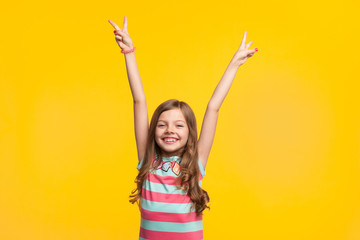 Young girl holding hands up smiling