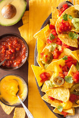 nachos loaded with salsa, guacamole, cheese and jalapeno