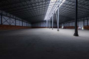 A huge metal construction warehouse. Grain dryer and threshing floor. Blurred-unrecognizable faces of people. Concept theme is the production of food and agricultural production.
