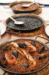 spanish seafood paella, black paella and fideua