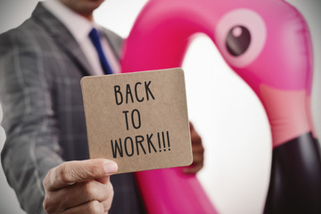 businessman and text back to work in a signboard