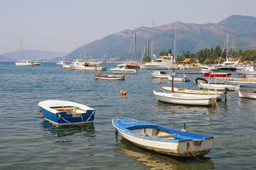 Fishing boats on the water near seaside village of Seljanovo. Bay of Kotor (Adriatic Sea), Tivat, Montenegro