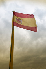 Flag of spain on cloudy day