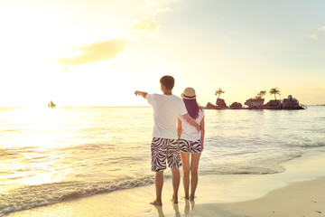 Young lovers on Boracay beach at  sunset ,Philippines.