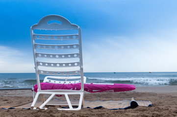 Chair on a cloudy day at the beach