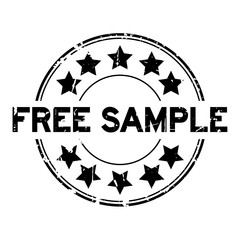 Grunge black free sample with star icon round rubber seal stamp on white background