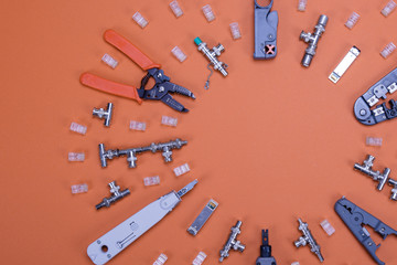 IT workshop set. System Administrator tools and devices on the board. Workset concept. Top of view on orange background