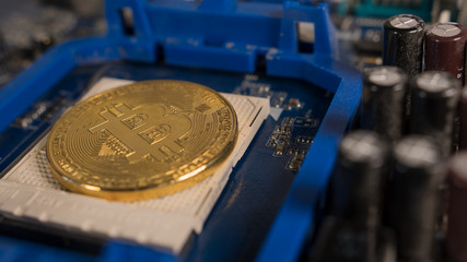 Bitcoin on the motherboard. Crypto currency Gold Bitcoin - BTC - Bit Coin.