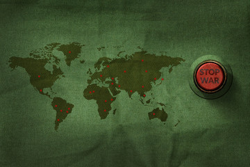 Stop War Concept, Button to push on World Map Military Fabric Texture background