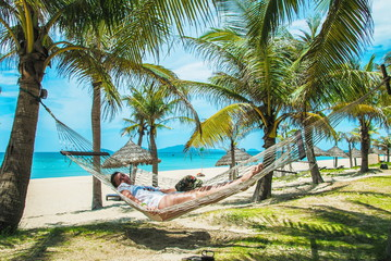 Relaxing girl on the Ang Bang beach. Hoi An, Vietnam