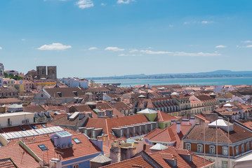 Orange tiles roofs in lisbon, Portugal, typical houses, panorama with the Tagus river in background
