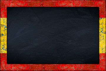 empty spain blackboard with wooden colorful frame isolated on white background / Spanien Tafel mit holzrahmen