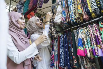 Two muslim ladies shopping for hijab