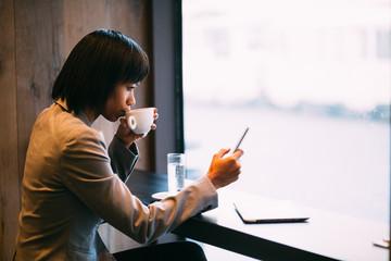 Black businesswoman working on coffee break