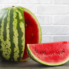 Watermelon on a gray wooden background
