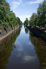 Kronstadt, Ruusia - July 16, 2014. A canal with green trees in Kronstadt. Kronstadt is city-fortress in the Baltic