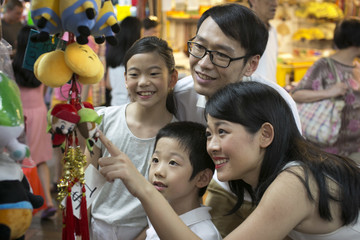Family of four enjoys shopping in Chinatown