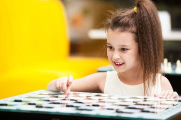 girl playing checkers