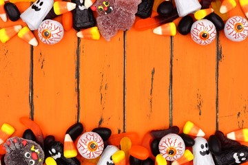 Halloween candy double border over an old orange wood background