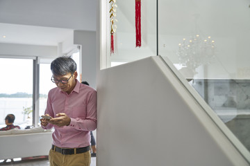 Father engrossed in his handphone