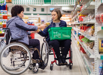 Two disabled women in a department store