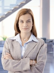 Confident attractive female business office worker