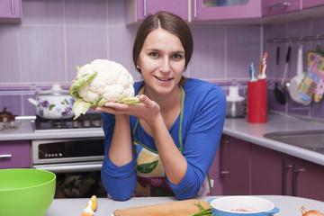 young woman preparing cauliflower
