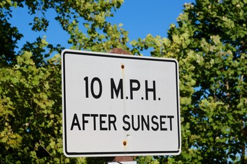 The speed limit sign after sunset sign.