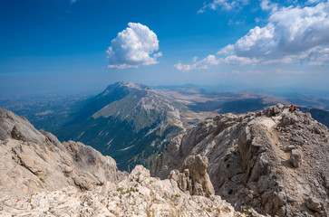 A high mountain range with peaks and plateaus on a warm summer day
