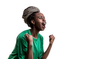 Afro girl wearing green uniform celebrates on white background