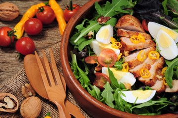 salad with chicken fillet, egg and tomato. dietary food.