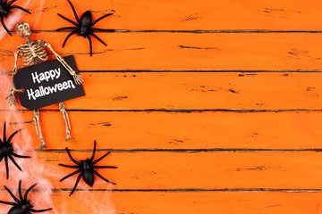 Happy Halloween tag with skeleton and spider web side border on an old orange wood background