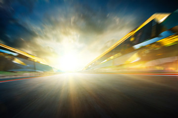 Wall Mural - View of the infinity empty asphalt international race track, digital imaging recomposition montage background . evening scene .