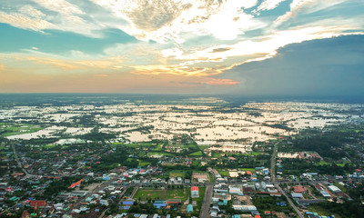 Aerial photo of small town and flood, Kasetwisai town, Roiet city Thailand