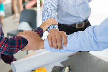 Businessman and engineer handshaking working hand together. industry business and Teamwork Concept.