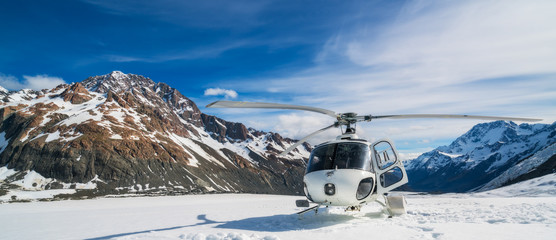 Printed kitchen splashbacks Helicopter Helicopter Landing on a Snow Mountain