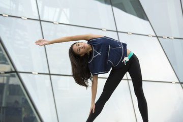 Young asian woman stretching