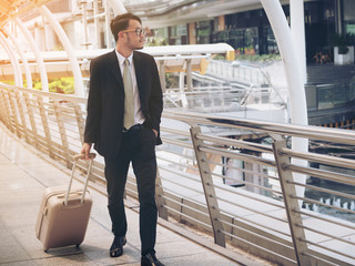 Businessman with travel bag is on business trip