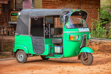 Small car with three wheels. Asian taxi tuk-tuk