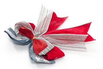 red and white ribbon bow isolated on white background